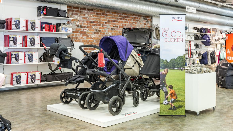 Adder bannerstand vid barnvagnar